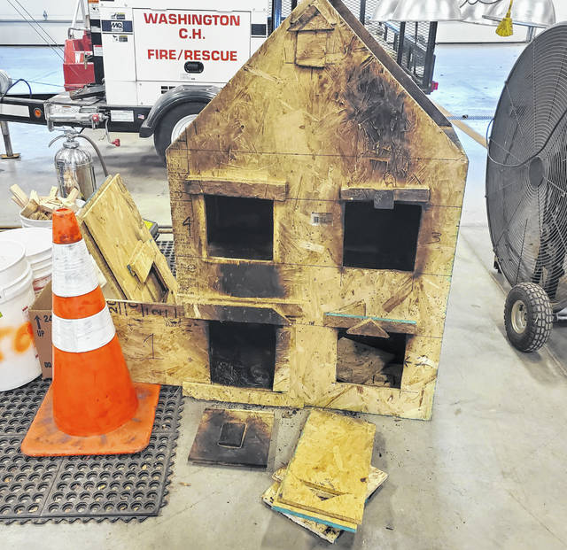Washington Fire Department firefighters built a miniature house using the same material that many homes are now built with. By using this house, they can see and demonstrate the way a fire spreads within a home depending on what rooms are open or sealed.