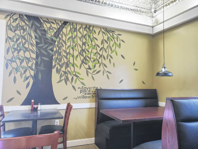 A mural of a willow tree painted on one of the dining room walls was able to be saved with a few touch-ups.