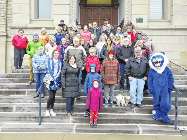 """On Thursday afternoon, various citizens of Washington C.H. gathered together on the courthouse steps for a group photo and short video taken by drone, which was manned by David Woolever from WCHC TV. The purpose of the video is to be included with an application to an upcoming new series """"Home Town Takeover."""" The series is to be hosted by Home & Garden Television (HGTV) stars Ben and Erin Napier, of the hit series """"Home Town."""" According to hgtvhometowntakeover.com, the series seeks to help communities revitalize their hometown with restoration work."""