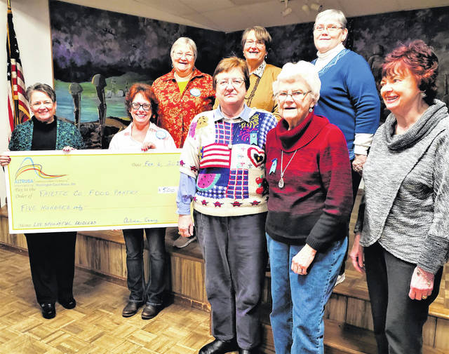 "In an effort to ""lead to a better community,"" Altrusa International of Washington C.H., Inc., donated $500 to the Fayette County Food Pantry during the February business meeting. The funds came from the club's October 2019 fundraiser, the popular ""Loving Spoonsful Tasting Luncheon."" Other recipients from that same event have been Cherry Hill Preschool's reading program, the Commission on Aging's Meals on Wheels, and the first ever college scholarship to a Fayette Christian School graduate. After the check presentation, Dr. Norma Kirby, one of three co-directors of the Food Pantry, updated the club on the history of the ecumenical project. Shown holding the $500 presentation check are Dr. Kirby and Loving Spoonsful co-chair Shelia Johnson. To their right are six Altrusans present at the meeting who volunteer regular shifts at the Food Pantry: from left (back row) Altrusa President Elaine Crutcher, Sara Creamer and Judy Levernier; (front row) Lauran Perrill, Mary Sue Spengler and Jennie Arnold."
