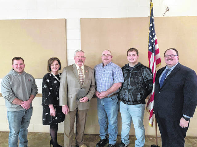 """Fayette County Chamber of Commerce President Julie Bolender and Nick Epifano, owner/operator of McDonald's of Fayette County, with Gene Baumgardner, owner of Ricketts Farm Inc., and the Ricketts Farm staff. Ricketts Farm was named the """"Agri Business of the Year."""""""