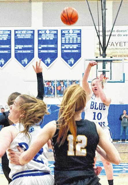 Washington senior Abby Tackage (10) puts up a shot during the rivalry game with Miami Trace Saturday, Feb. 8, 2020. Tackage scored a career high eight points as Washington won by eight, 56-48.