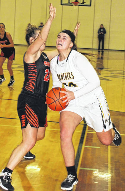 Miami Trace junior Delaney Eakins takes the ball strong to the basket during a Sectional championship game against the Waverly Tigers Saturday, Feb. 15, 2020 at Adena High School. Eakins had a double-double, scoring 14 points and grabbing 11 rebounds in a 50-36 Miami Trace victory.