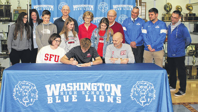 Washington High School senior Eli Lynch, seated, middle, signs a letter of intent to attend Saint Francis University where he will continue his education and his athletic career for the Red Flash football team. He was joined by his parents, Jennifer and Zack and in back (l-r); cousin Madeline Lynch, aunt Kelli Lynch, cousin Evan Lynch, uncle Ryan Lynch, sister Mollie Lynch, grandmother Vicki Lynch, sister Ellie Lynch, grandfather Dale Lynch, head coach Chuck Williamson, wide receivers coach Tyler Flora and coach Eric Downey. The ceremony was held in the lobby outside the gymnasium at Washington High School Wednesday, Feb. 5, 2020.