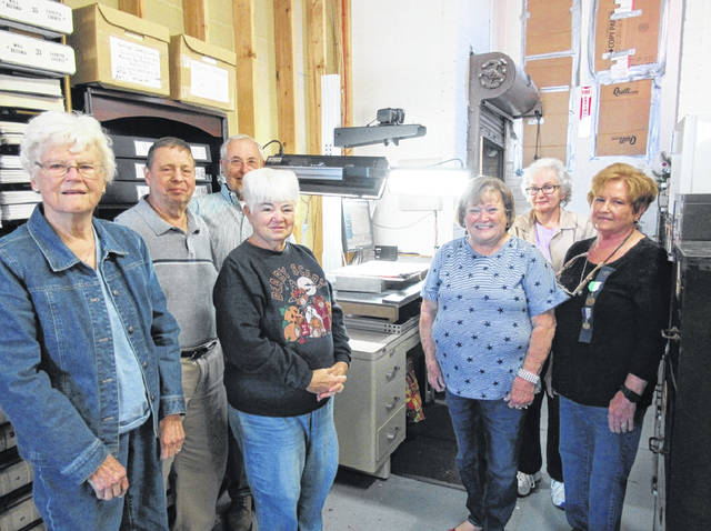 Volunteers in front of the scanner at the old Armory are left to right: Mary Sue Spengler, Ron Lott, Don Moore, Peggy Lester, Sue Gilmore, Jane Ford, and Cathy Massie White. Those not shown are Glenna Parsley, Jill Roberts, Gary Mickle, Karen Healy, Helen Brown, and Diana Febo.