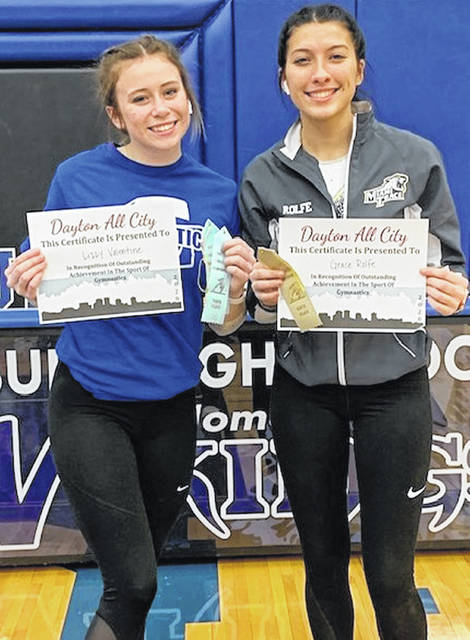 Two local gymnasts received Top 10 honors at the Dayton City Championships Saturday, Feb. 15, 2020. (l-r); Lizzy Valentine, Greeneview, placed 10th on floor exercise with an 8.625 score; Grace Rolfe of Miami Trace was ninth on vault with a score of 8.15.
