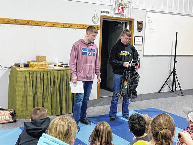 Kylan Knapp and Graham Carson demonstrated wrestling equipment and moves for the Top Performers 4-H Club.