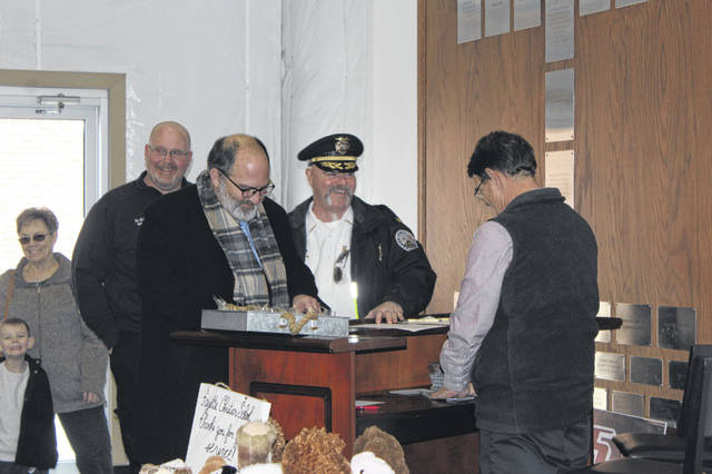 Fayette Christian School and Fayette Bible Church held its annual First Responders Luncheon on Thursday to honor those who protect our community. Pictured are Washington Court House City Manager Joe Denen and Washington Police Department Chief Brian Hottinger being greeted by Fayette Bible Church Pastor Tony Garren.