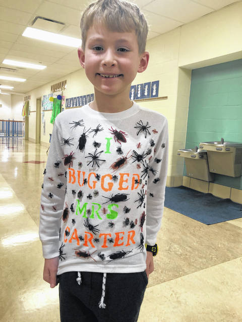 "Washington Court House City Schools' first grade students in Mrs. Mykalley Carter's class at Cherry Hill Primary celebrated the 100th day of school on Tuesday. Benson Schrader wore this shirt and shared how he has ""bugged"" his teacher ""for 100 days"" as it says on the back."