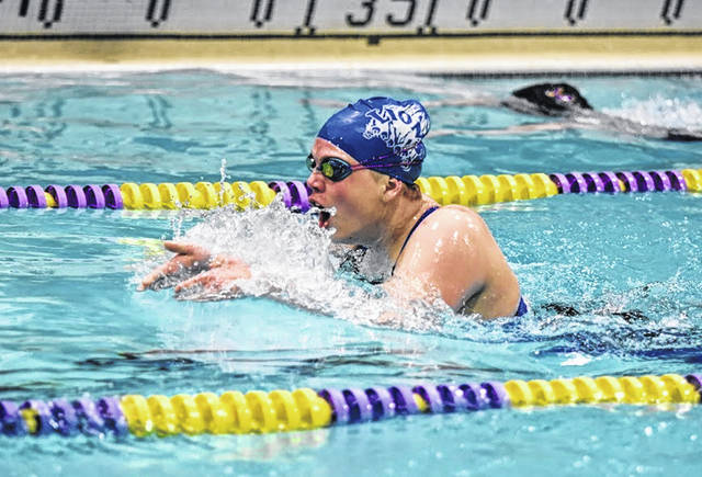 Washington High School junior Julianne Bailey competes in the 100-yard breaststroke during the Frontier Athletic Conference swim meet at McClain High School in Greenfield Wednesday, Feb. 5, 2020. Bailey won this event in 1:18.96.