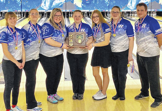 The Washington Lady Lion bowling team and coach after winning the Division II District championship at Shawnee Lanes in Chillicothe Friday, Feb. 21, 2020. (l-r); Brooklyn Foose, Jessika Young, Ali Reeves, Maitlyn Cave, Lindsey Buckner, Hanna Yoho and head coach Anthony Amore.