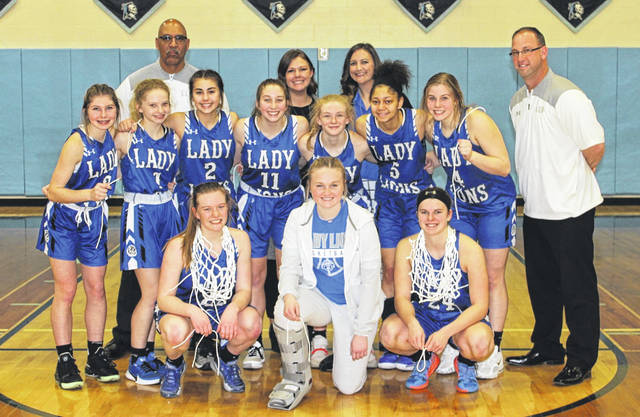 The Washington Lady Blue Lions won a Sectional championship with a 58-47 victory over Fairfield Union Saturday, Feb. 15, 2020 at Adena High School. (front, l-r); Halli Wall, Abby Tackage, Shawna Conger; (second row, l-r); Kaelin Pfeifer, Allie Mongold, Aaralyne Estep, Megan Sever, Natalie Woods, Jeleeya Tyree-Smith, Kendall Dye and Coach Corey Dye; (back, l-r); Coach Mychal Turner, trainer Ashley Henry and Head Coach Samantha Leach.