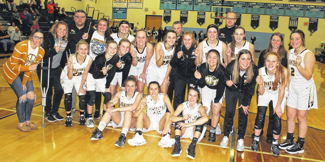 The Miami Trace Lady Panthers won a Division II Sectional championship Saturday, Feb. 15, 2020, defeating Waverly, 50-36 at Adena High School. (front, l-r); Grace Bapst , Shaylee McDonald , Aubrey McCoy; (second row, split up, at left); Audrey Craig, Hillary McCoy, Mallory Lovett (second row, at right); Mallory Pavey, Gracee Stewart, Magarah Bloom; (back, l-r); Piper Grooms, Addy Little, Coach Shawn Grooms, Katie Hicks, Delaney Eakins, Lilly Workman, Hillery Jacobs, Head Coach Ben Ackley, Emma Pitstick, Libby Aleshire, Coach Brian Southward, Gracey Ferguson, Coach Kayla Dettwiller and Sidney Payton.