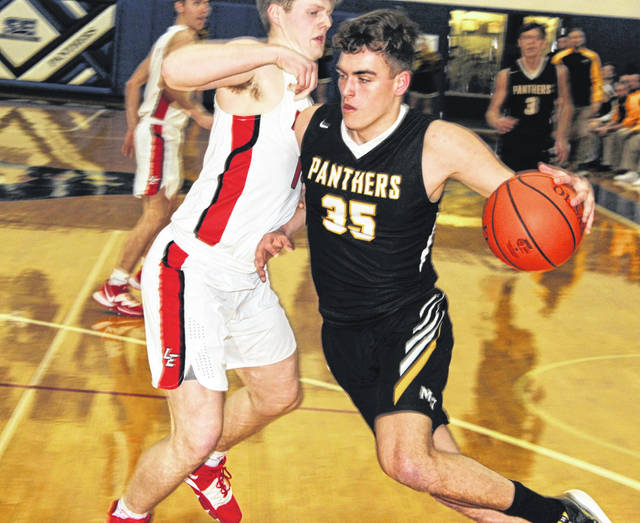 Miami Trace junior Logan Rodgers drives against a player from Logan Elm during a Division II Sectional semifinal game at Southeastern High School Wednesday, Feb. 19, 2020.