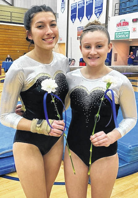Senior gymnasts were recognized at the Dayton City Championships at Miamisburg High School Saturday, Feb. 15, 2020. From Miami Trace High School, the seniors are (l-r); Grace Rolfe (third year on the team) and Devan Thomas (fourth year on the team.