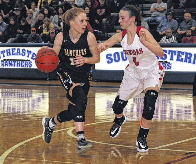 Miami Trace junior Magarah Bloom runs the offense while guarded by Sheridan junior Grace Conrad during a Division II District semifinal game at Southeastern High School Friday, Feb. 21, 2020.