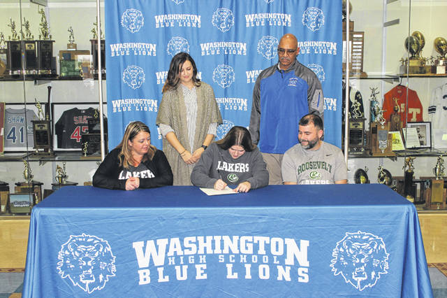 Washington High School senior Shawna Conger (seated, middle) signs a letter of intent to attend Roosevelt University in Chicago, where she will study early childhood education and be a member of the Lakers women's basketball team. She is joined by her parents, Erika and Shawn and coaches Samantha Leach and Mychal Turner. The ceremony was held in the lobby of the WHS gymnasium Thursday, Feb. 6, 2020.