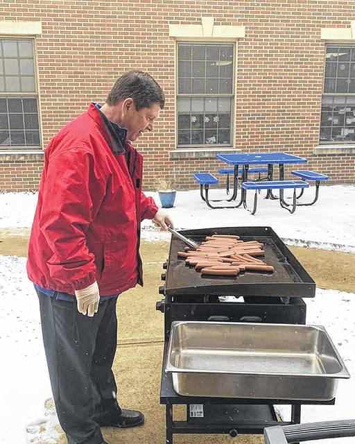 On Friday, Washington Court House Belle Aire Principal Jeff Conroy didn't let the snow stop him from grilling hot dogs for the students who met their monthly math challenge, just as the winter weather didn't stop the little Blue Lions from learning at school for the day.