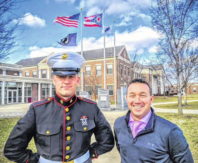Washington High School recently had a surprise visit from Blue Lion alumnus Private Colten McNichols (L). PVT McNichols, a member of the WHS Class of 2019, enlisted in the Marine Corps as a combat engineer and stopped by to see the other students and Principal Tracy Rose (R) after successfully completing boot camp and prior to heading to Camp Geiger, NC.