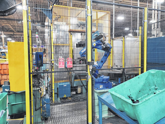 Several robots are in use in the facility that have lessened the physical demands of the job, according to Brice Graham.