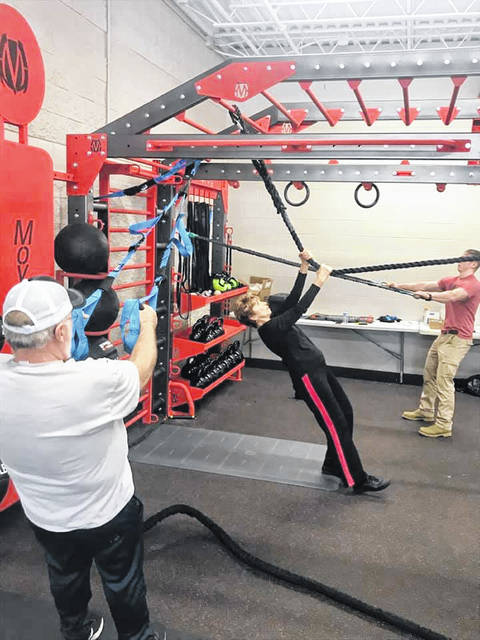 "The Fayette County Family YMCA announced Friday that it will hold an open house for its new expansion on Feb. 22. Pictured are various YMCA employees learning how to use the new ""Movestrong"" Rig."
