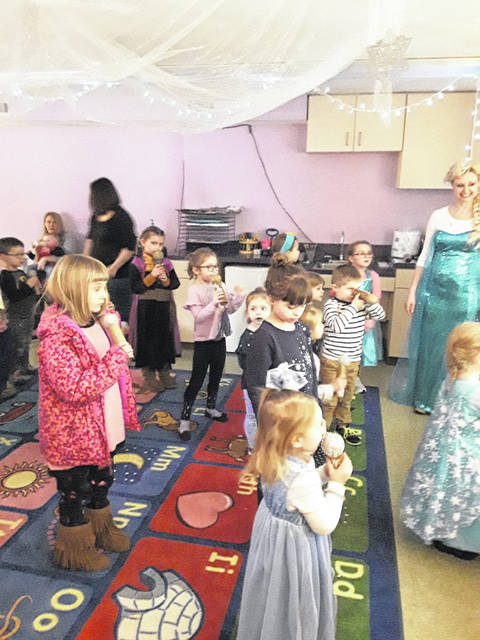 """Children sing along with their homemade microphones, and belt out all the tunes to """"Frozen."""""""