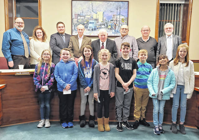 Belle Aire Intermediate students, who are also members of Lego Lions, attending the Washington Court House City Council meeting on Wednesday to request for more trash cans to be placed in Eyman Park. Pictured (back, L-R): City Manager Joe Denen along with council members Kendra Redd-Hernandez, Caleb Johnson, Steve Shiltz, Jim Chrisman, Ted Hawk, Dale Lynch and Jim Blair, pictured (front, L-R): Lily Appel, Gatlin Rogers, Kinsley Caudill, Anna Tackage, Sam Pfeifer, Cam Stritenberger, Mira Robinson and Mylee Picklesimer.