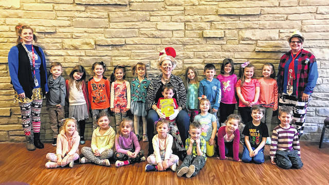Miz Anne from Carnegie Public Library reads Dr. Seuss's Wacky Wednesday to Miss Stacy's and Miss Sara's preschool students at Grace Methodist Church.