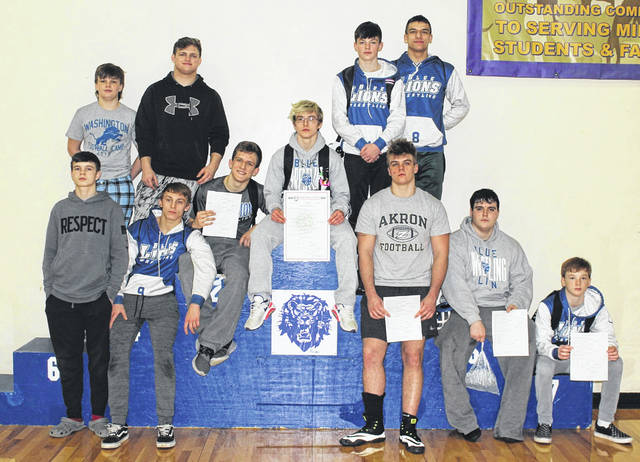 The Washington Blue Lions are sending 12 wrestlers to the District meet that is being held Friday and Saturday at Claymont High School. (front, l-r); Josiah Whitt, Connor Day, Kalub Wilkerson, Branton Dawes, Collier Brown, Mason Mustain, Ian Roush; (back, l-r); Coty Brown, Chase Sluder, Bryce Warner and Jared Kuhn. Not pictured: Dylan Moore. Washington's Mason Mustain wrestles Kai Borrelli of McClain at 285 pounds in the semifinals at the Division II Sectional at Washington High School Saturday, Feb. 29, 2020.