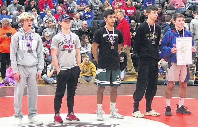 Washington Blue Lion sophomore Branton Dawes (at left) placed fifth at the District tournament Saturday, March 7, 2020 at Claymont High School to become a State-alternate.