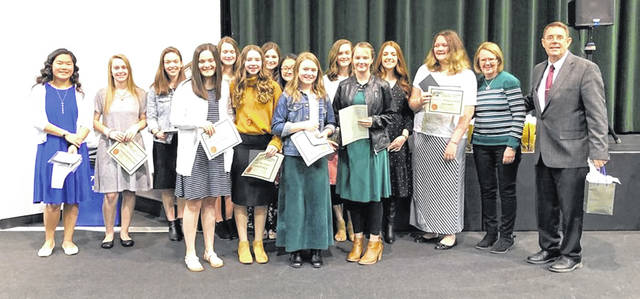 The Fayette Christian School girls basketball team is pictured following an awards presentation on March 5, 2020. (front, l-r); Ally Barker, Katlyn Bock, Luisa Epifano, Keziah Knepp; (back, l-r); Grace Sheeter, Stephanie Stollings,Emily Barker, Katelynn Crichton, Makenna Granger, Megan Sheeter, Letisha Knepp, Ryleigh Tooill, Elli Lewis, Lynn Garren, Pastor (and head coach) Tony Garren.