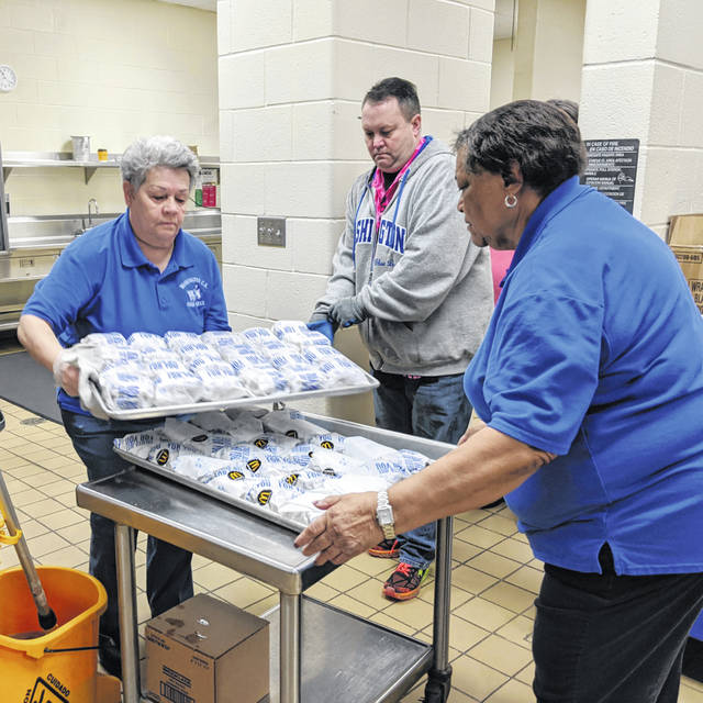 Several Washington Court House City Schools staff members and volunteers worked together to make the venture of feeding numerous youths possible after the school was shut down for three weeks due to state regulations during the COVID-19 pandemic.