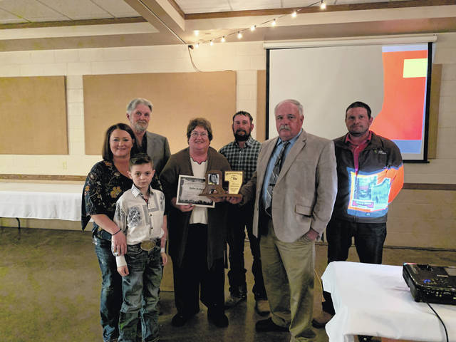 Robin Beekman, surrounded by family, was inducted into the Fayette County Ag Hall of Fame on Thursday. Ron Weade presented the award.