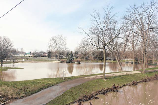 Washington Park seemingly gained a third pond due to the flooding as the parking lot was still nearly completely submerged on Sunday and a closed sign was placed at the driveway.