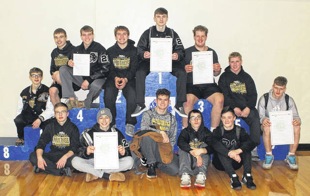 Miami Trace will be sending 12 qualifiers and one alternate to the Division II District wrestling tournament Friday and Saturday at Claymont High School. The Panthers are pictured on the podium at the Sectional tournament at Washington High School Saturday, Feb. 29, 2020. (front, l-r); Shane Seymour, Weston Melvin, Dawson Wallace, Aiden Johnson, Aaron Little; (back, l-r); Titus Lehr (alternate), Treven Shoemaker, Graham Carson, Bryce Bennett, Storm Duffy, Grant DeBruin, David Tyndall and Jayden LeBeau.