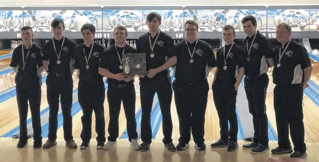The Miami Trace bowling team with their District runner-up trophy at Sunrise Strikes in Zanesville Monday, March 2, 2020. (l-r); Connor Collins, Jayden Brown, James Kysor, Jay Caudill, Andrew Amore, Brendan Major, Chris Evans, Brian Everhart and head coach Ron Amore Sr.