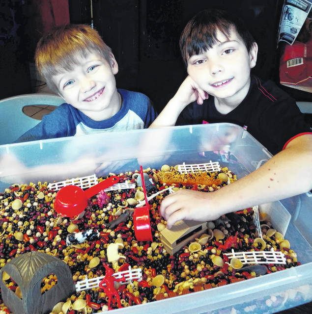 While schools are closed during the COVID-19 pandemic, 8-year-old Draven (R) and 5-year-old Zaden (L) Sullivan are being kept busy with homeschooling, sensory bins, and outside play when the weather is nice. According to their mother, Monica Matthews, the boys' favorite bin is comprised of oats most likely due to the texture.