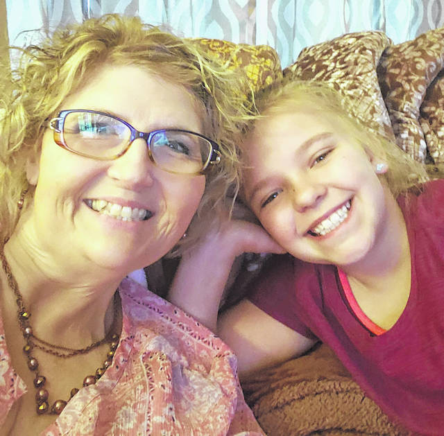 """Sue Shope (left) explained that her young neighbor, Trinity (right), serves as inspiration for wanting to make kids smile. One way to do this, according to Shope, is by coming together as a community to give kids a creative and fun activity to do such as """"hunting"""" stuffed animals and eggs in windows."""