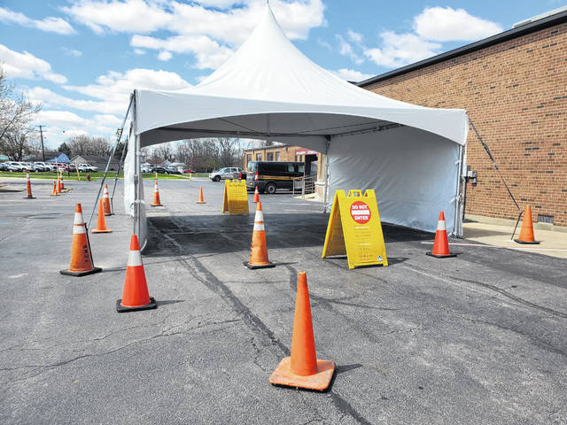 A tent was placed outside the Fayette County Memorial Hospital Emergency Room exit as a method to assist the public during the current COVID-19 pandemic. This tent may serve as a location for extra space if a surge in hospitalizations occurs, as a swabbing station to test individuals for the virus if more tests are eventually received, or to serve as a space to offer breathing treatments for those experiencing respiratory distress.