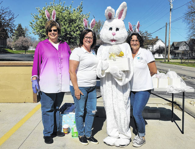 On Wednesday, the Life Pregnancy Center passed out Easter baskets drive-by style as many families will not get to go Easter-egg hunting this year. Those assisting with passing out gifts included (left-right) Debbie Hill, director Shawn Lachat, Melissa Kobel and Gail Powell. Not pictured is Kathy Shriver, who was directing traffic for the event. Precautions were being taken such as wearing gloves, according to Hill.