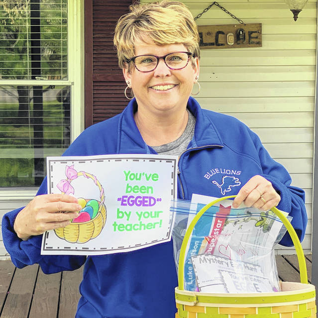 "Washington Court House City Schools' second grade teachers, including Wanda Carter, ""egged"" their second grade students this week. The goody bags included plastic eggs with different riddles and educational puzzles that needed solving in order to complete a secret code hidden in a poem."