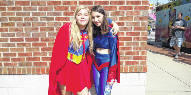 "During the 2019 Scarecrow Festival, superheroes courtesy of the Washington Court House City Schools' choir joined in the festival. Super Girl (L) and Wonder Woman (R) explained they were walking around and taking photos with any children who wanted to see them. ""We try to make little kids' days,"" said Super Girl."