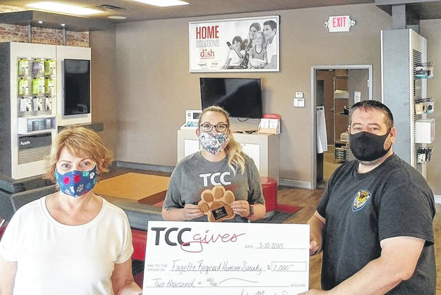 The Fayette Regional Humane Society recently received a TCC Gives grant through TCC Verizon worth $2,000. The grant was received with the assistance of the local TCC Verizon store manager Loren Blizzard (middle) and staff. Executive Director Dr. Lee Schrader (left) and Chief Humane Agent and Outreach Director Brad Adams (right) are shown presenting Blizzard with a plaque for the staff's enthusiasm and dedication to FRHS's lifesaving work.