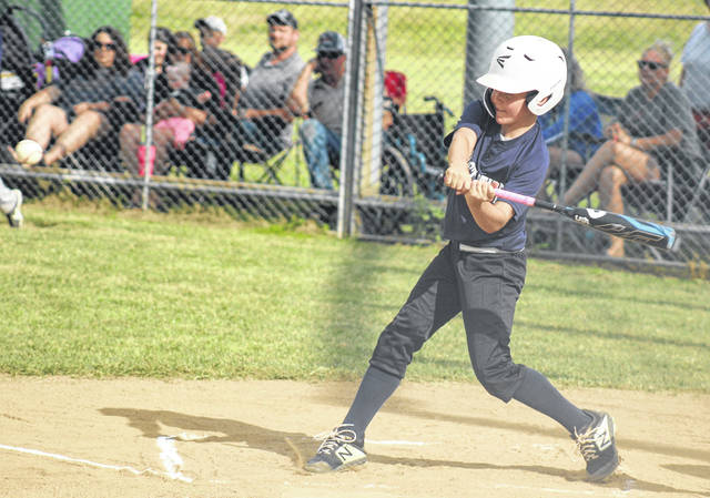 Aden Osborne gets a hit for First State Bank in the game against SVG Tuesday, June 16, 2020 at the Little League complex on Lewis Street. Osborne later scored the first run of the new season.