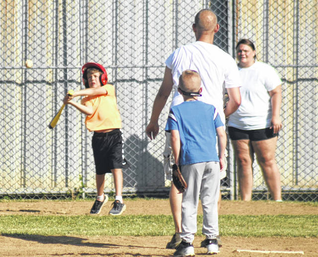 A member of the Donato's Minor Division team takes a swing during practice Thursday, June 11, 2020 at the Washington C.H. Little League complex on Lewis Street. The league will begin its 66th season Tuesday evening.