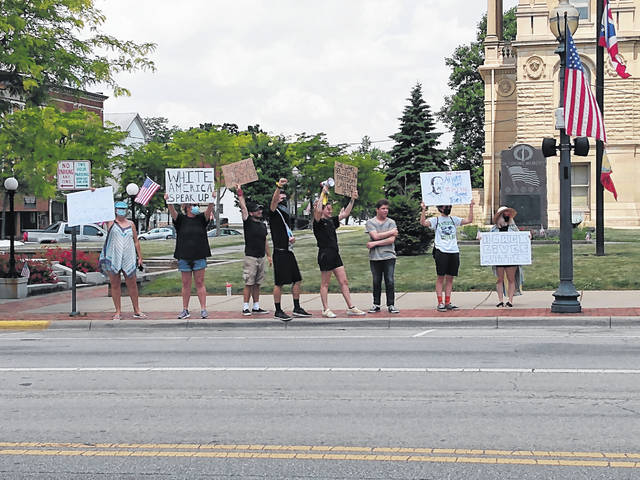 On Saturday afternoon a group of residents gathered at the Fayette County Courthouse to protest police brutality in the United States and stand with African-Americans across the country marching for the #BlackLivesMatter movement. Protesters talked with community members driving past and cheered at any who honked in support of their protest.