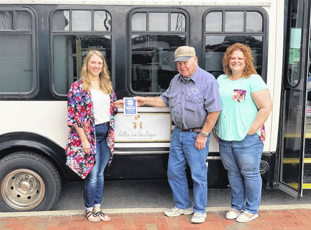 Lottie Mo Boutique, established December 2018, specializes in children's fashion and handmade hair accessories. Look for the bus parked on Court Street most Saturdays. The City of Washington Court House recently presented the business with a New Business Plaque. (Left to Right) Margo Robinson, Owner, Jim Chrisman, City Council member and Kara Bruney, Main Street Fayette President.