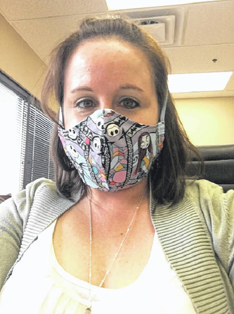 "Heather White is wearing her ""Nightmare Before Christmas Mask"" which was made by her mother Cathy Massie White. Both Heather and Cathy are members of the Fayette County Genealogical Society."