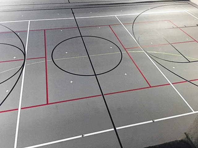 The YMCA began phases of its re-opening last week with a series of various activities planned to help get it ready for the public. Pictured is the field house showing spots marked at least eight feet apart for group exercise classes.