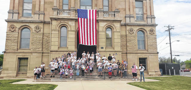 Approximately 75 volunteers assisted local non-profit Flags Over Fayette with placing flags throughout the main streets of Washington Court House and along the courthouse yard as part of the second-annual Flag Day celebration. See more photos inside.